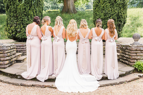 Bridal-Party-in-the-Courtyard-at-Coombe-Lodge