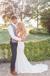 Bride-and-groom-in-the-gardens-of-Coombe-Lodge
